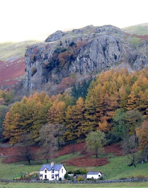 Looking up from the road to Castle Rock of Triemain. Climbers are visable on the right of the South Crag,with the steep North Crag to he left. Photo Dave Richardson
