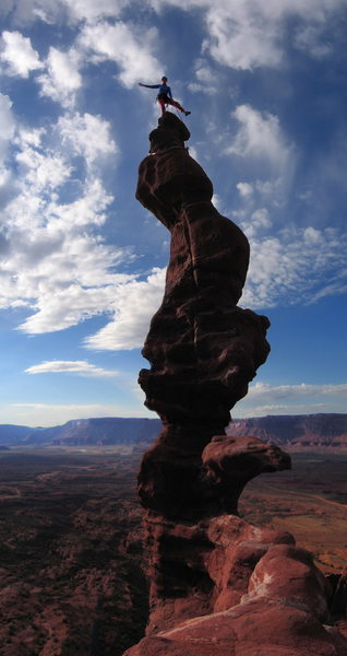 Kim Levans on top of Ancient Art, in the Fisher Towers, UT.  This is 3 images stitched together vertically, shot with an old cannon elph