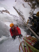 Rock Climbing Photo: Carl Pluim arriving at our top out next to the han...