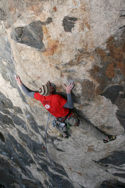 Skipping the anchor of 100 proof, and slabing it up to the base of the Roof routes. <br> -photo by Darren Mabe.