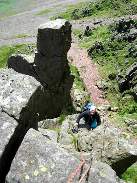 Climber on Needle Ridge ,with the top of Napes Needle behind . Photo Ron Kenyon