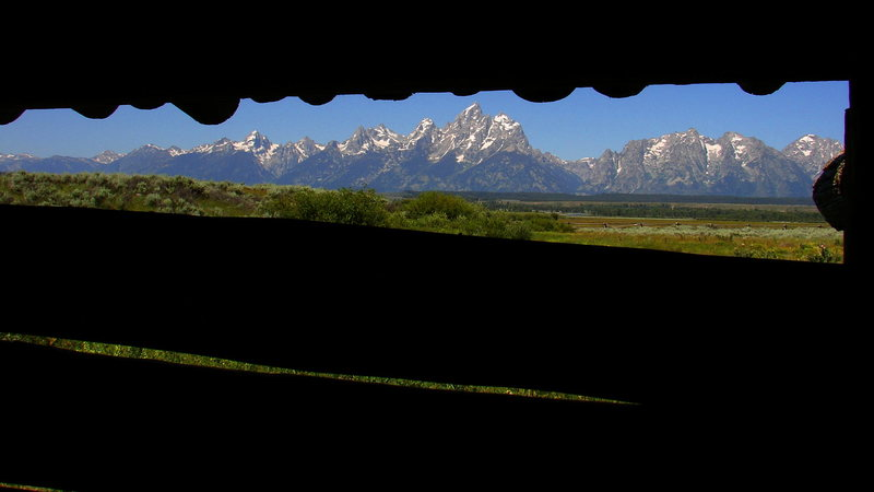 The Tetons through cabin slats.