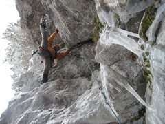 Rock Climbing Photo: Hitting the old fixed soft steel pin in the roof.