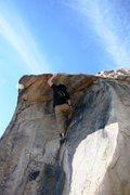 Rock Climbing Photo: Starting the crux sequence on Antenna Roof, V1