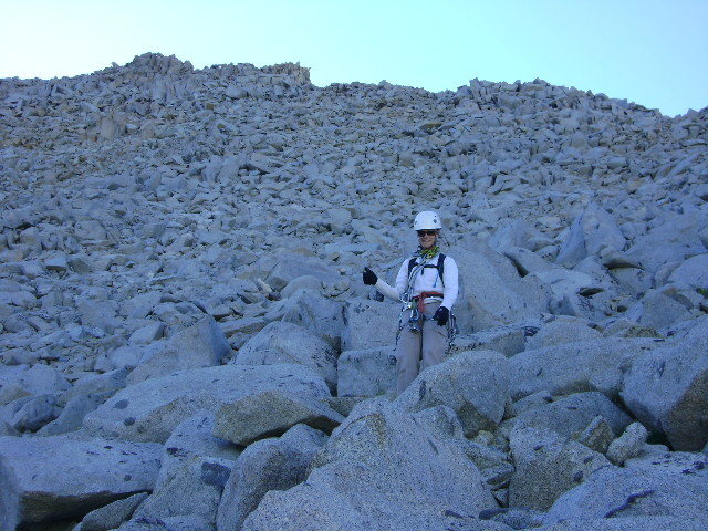"Tracy McDermott nearly to the end of the talus field on the backside descent, almost to the ""sand""."