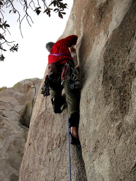 Luke in action leading the crux hand crack of Falling Ross on Granite Mountain.