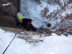 Rock Climbing Photo: Getting Tenacious for the crux exit moves. Photo b...