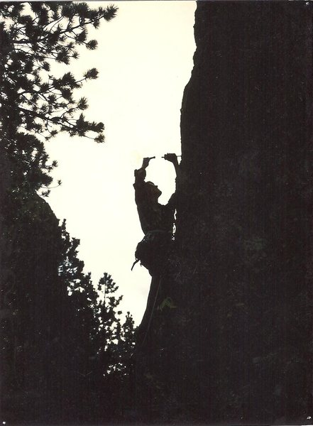 Drilling the first bolt on lead during the first ascent.