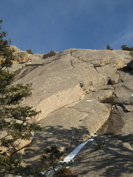 Sky Crack (in all its glory) ascends the right-angling dihedral to the crack system above the small overhang at its end.