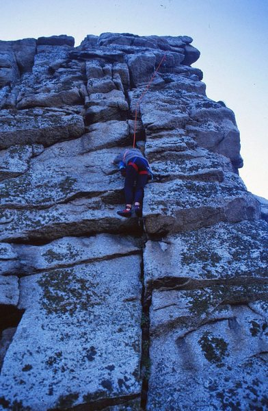 Ann climbing up the starting crack of Saladin, 5.7
