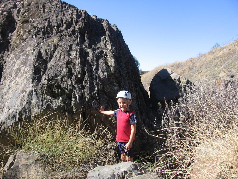 My nephew Logan playing on the boulders in the gully by my house.