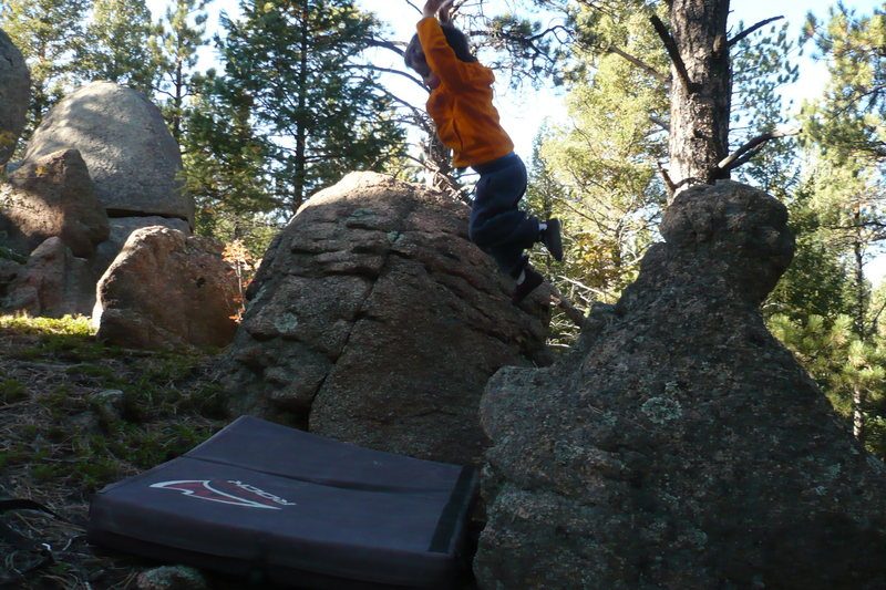 Rock Climbing Photo: He really likes jumping onto the pad more than cli...