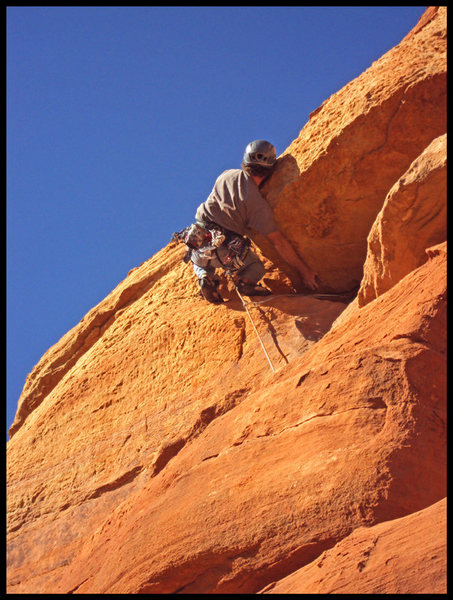 Cody Lane works around the final roof moves on the 4th pitch of The Fisher King in Sedona, AZ.