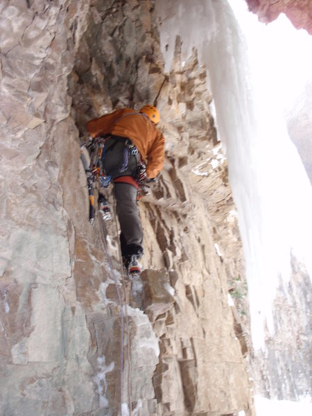 "A miner in a hole with ""White Gold"".  Headed up onto the free-hanger, on the start to Left Corner of Hidden Falls.  The pin is just above my left shoulder, straight up in the roof."