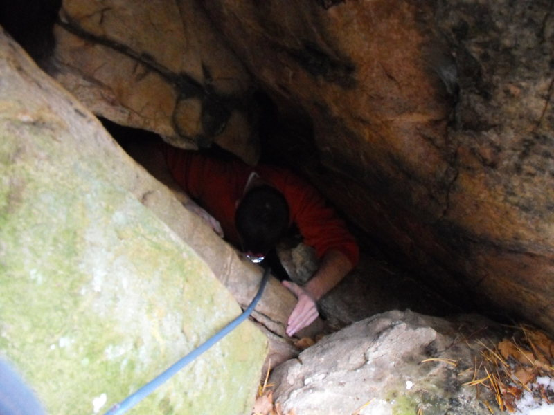 Rock Climbing Photo: Squeezing out of the top!