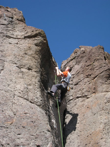 Jason starting the committing crux at the end of the route, just before completing his redpoint. He sent it despite Z-clipping on each of the last 3 closely spaced bolts. 2/2010