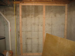 Rock Climbing Photo: 2x4s bolted to foundation cement, ready to install...
