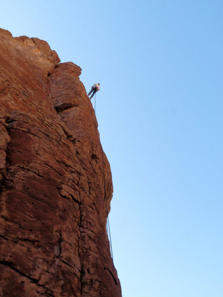 Geir rapping from the newly installed rappel anchor on Entrance Tower.