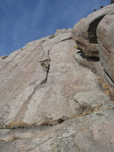 P1 of Jetstream.  The bushes at the base of the photo are actually on the edge of a sizable grassy ledge.  Scramble a couple boulders to gain the ledge to rack up and belay.