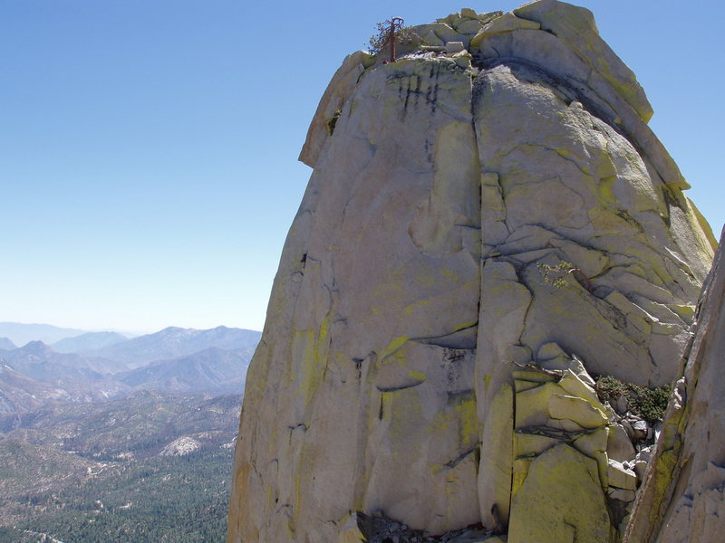 climber belaying second on top of thin ice, needles, CA