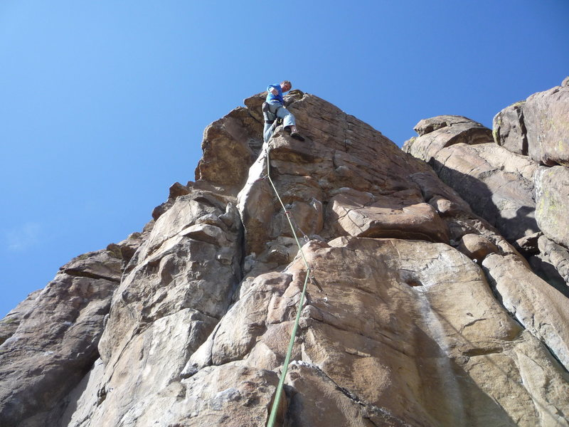 On the upper arete where the route moves right.