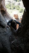 Rock Climbing Photo: Hanna entering the Shmotem Hole after pausing to s...