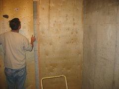 Rock Climbing Photo: Beginning to screw panels to wall
