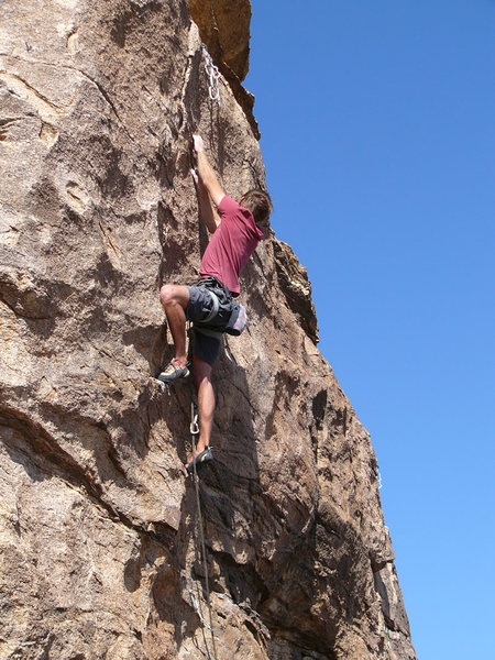 Joe Kreidel having just pulled through the crux.
