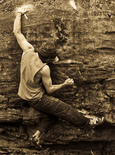 "Aaron James Parlier on ""Domino"" (V-7) in the Belly Boulder Area, Mcafee's Knob, V.A., 2009"