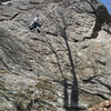 Jakob working out the moves up on the crux...