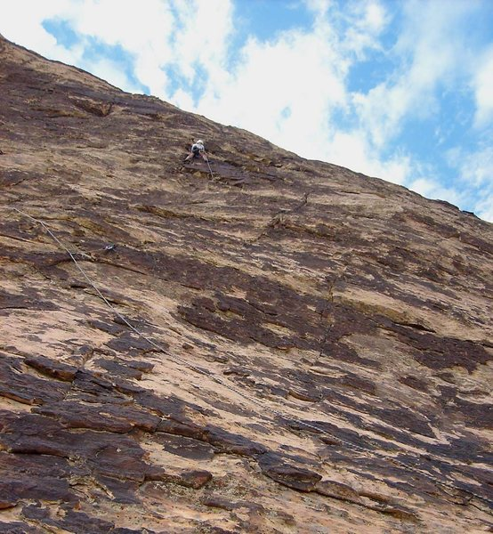 High on the first pitch of Summerset, approaching the belay spot.