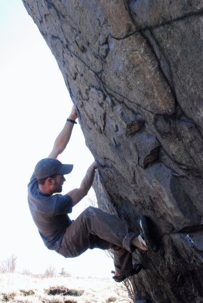 "Aaron Parlier rides up the left side of the lonely boulder on ""Left Side Ride"" (V-0)"
