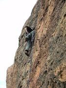 Rock Climbing Photo: Mustafa pulling down on the brilliant orange flake...