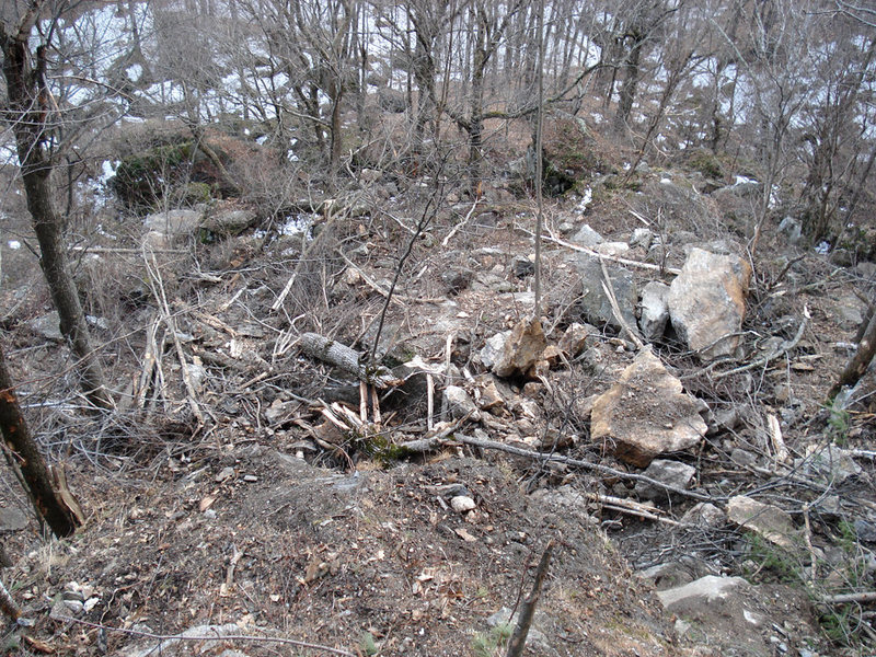 destruction at the base of main cliff as seen from above the trail... well that used to be a trail...