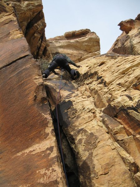 Pitch 5 - short escape pitch.  Climb the crack directly above the climbers head and walk off to the left.