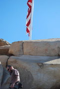 Rock Climbing Photo: Nate near the flag on top of the boulders near the...