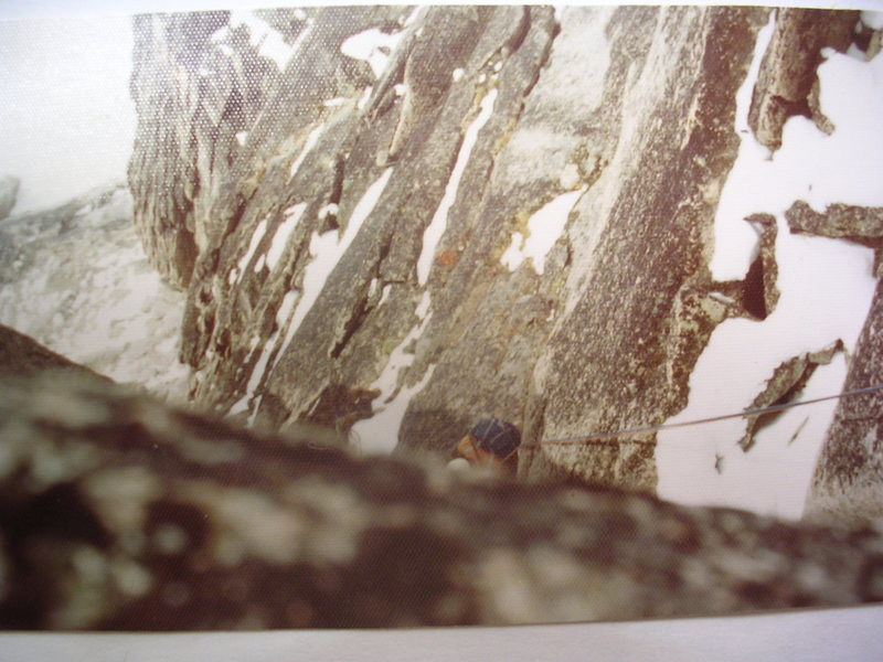Looking down from the summit as Alain Henault begins the rappel descent of Kraus-McCarthy, August, 1974.