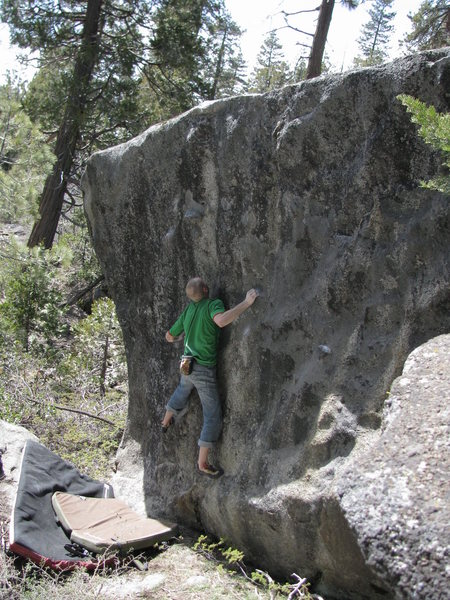 A V2 slab down the hill from the Marble Fork overlook boulders.