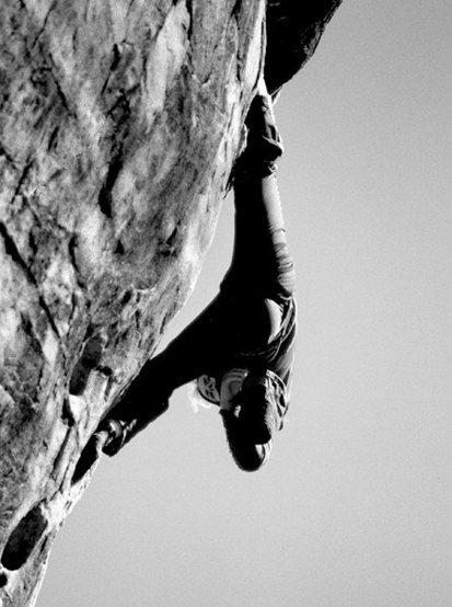 Lynn Hill resting off a heel hook.<br> Red Rocks 1981.