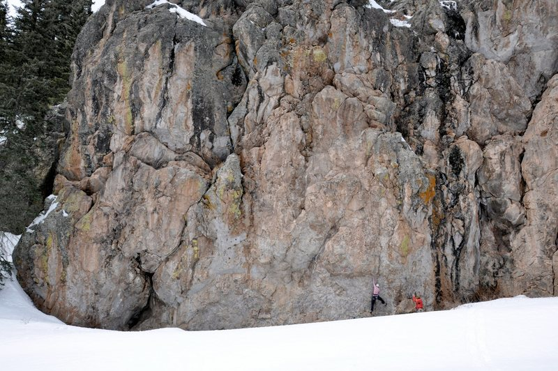 Working into the crux of Mr. Dubious. March 2010. It looks like she's barely off the ground but the snow was drifted up about four feet high but a small trough at the wall's base was snow-free.