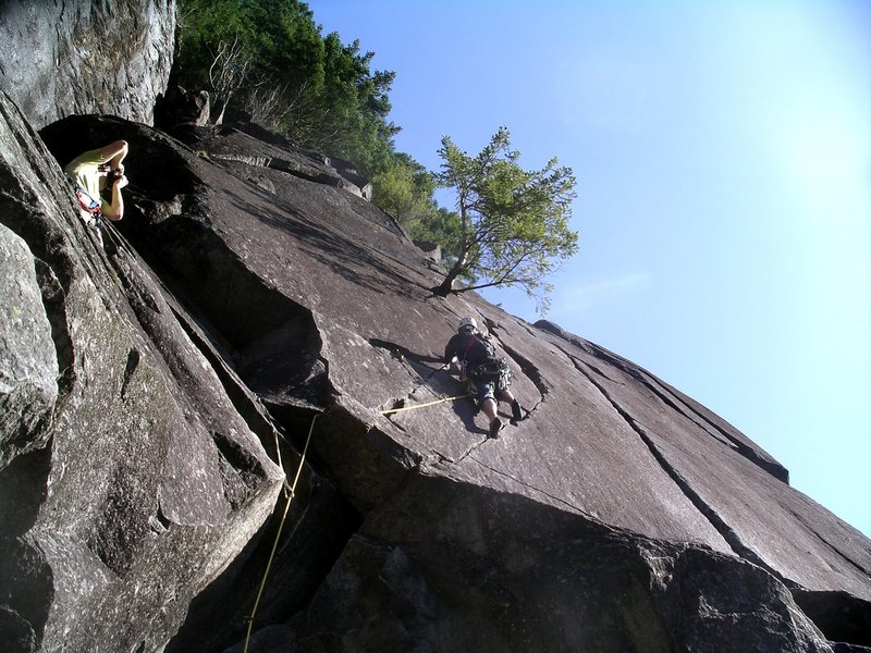 Pisces is the straight, splitter hand crack located to the right of the climber on Great Northern Slab.  Pisces sits on top of Libra Crack, but the harder Libra can be bypassed to the right.