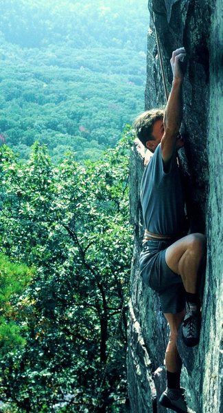 It would appear,.. by the rich verdant hues of the distant hillside, sometime in the summer of '87. Eric Z. cranking an early ascent,... with a bowline on a coil. Oh Yeah!