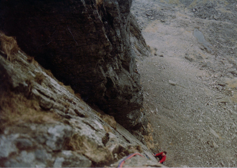 Following up Pitch 5. Walsh's Groove (West Buttress Eliminate) is the black groove on the left.