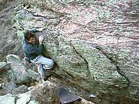 Matt Samet on the Warm-Ups on the Left Illness Boulder. (Photo taken from frontrangebouldering.com.)