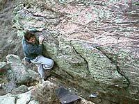 Matt Samet on the Warm-Ups on the Left Illness Boulder. (Photo taken from frontrangebouldering.com.)
