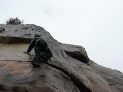 Rock Climbing Photo: Pete on Irish toothache in the rain. Photo by Todd...