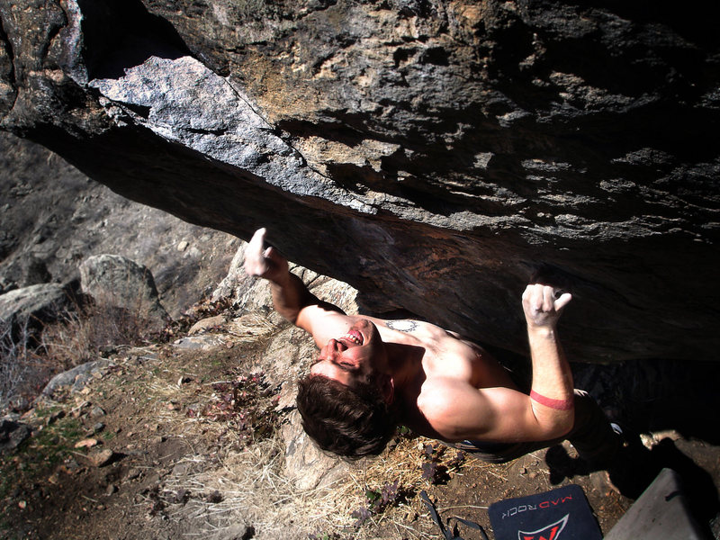 "Jason Baker charging forward for the send on the mega thin ""Rhino (V10).""  Clear Creek Canyon, Colorado."