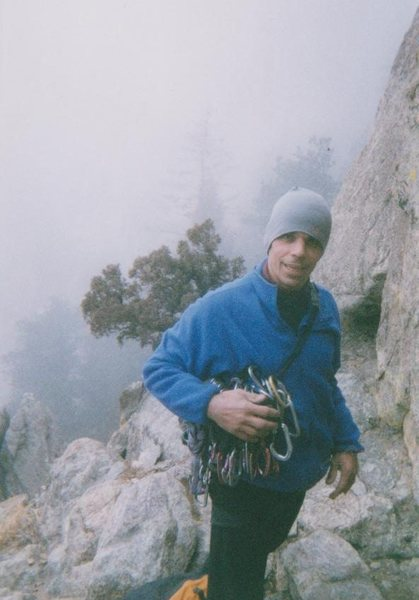"This shot is from January, 2000.  It was cold as *!@#, and snowing on and off.  Rock is racking up to lead ""Stellar Drifter"" at ""Japanese Garden"", in Boulder Canyon. He hiked it."