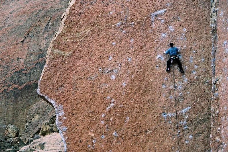A good view of a climber on Heinous Cling, with Darkness at Noon immediately left and Chain Reaction on the left arete. Photo taken Sept 97.