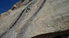 Rock Climbing Photo: On the FA drilling the first of 3 crux bolts.